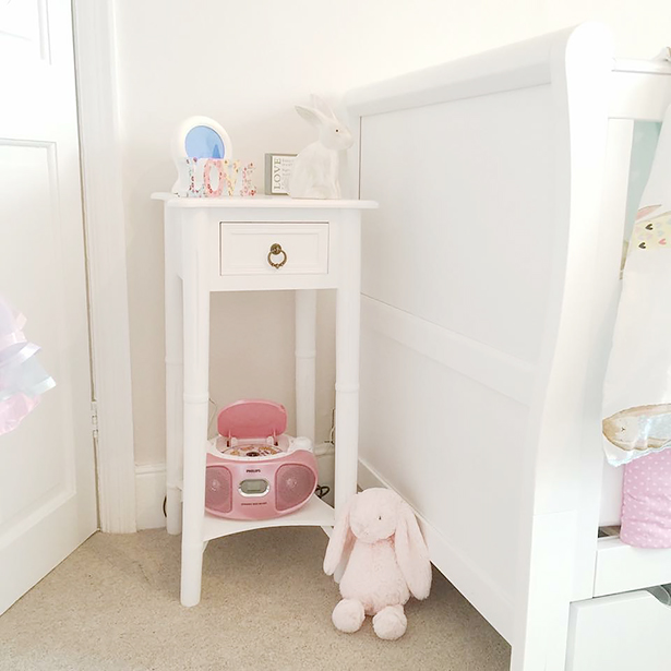 Our New England white bedside table in a nursery
