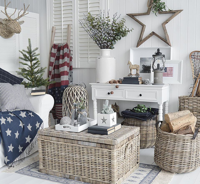 New England decor in a living room full of character in traditional stars and stripes american home interior. Furniture and accessories from The White Lighthouse