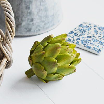 A very realistic decorative artichoke in vibrant green... Looks stunning in a bowl or dish on the kitchen countertop