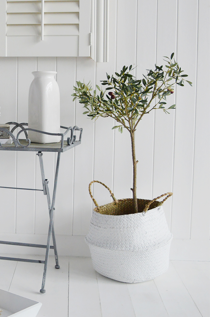Realistic artificial olive tree shown in Kingston Baskets
