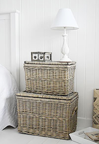 Grey baskets as a bedside table offering storage