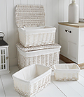 Set of 4 white baskets