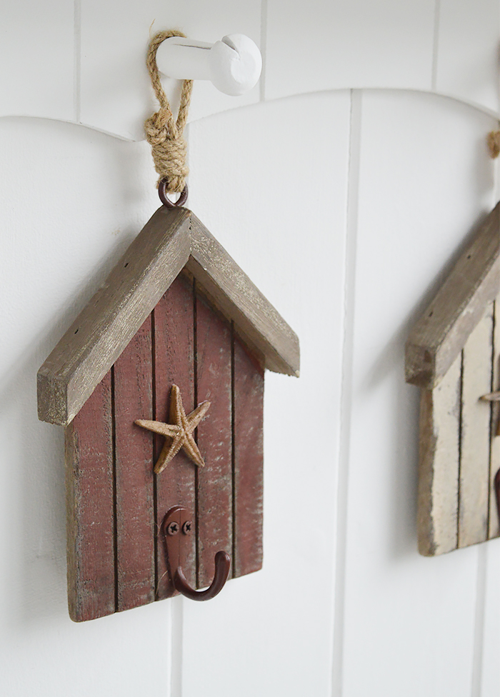 The White Lighthouse. White Furniture and accessories for the home. Three beach hut hooks in rustic weather beaten paint in coastal colours, each with a starfish and painted hook hanging on cord. Decor designed to perfectly complement our New England Coastal and Country home interiors with our bedroom, living room and hallway white furniture - red