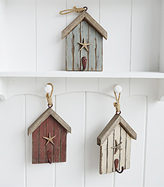 The White Lighthouse. White Furniture and accessories for the home. Three beach hut hooks in rustic weather beaten paint in coastal colours, each with a starfish and painted hook hanging on cord. Decor designed to perfectly complement our New England Coastal and Country home interiors with our bedroom, living room and hallway white furniture