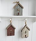 The White Lighthouse. White Furniture and accessories for the home. Three beach hut hooks in rustic weather beaten paint in coastal colours, each with a starfish and painted hook hanging on cord. Decor designed to perfectly complement our New England Coastal and Country home interiors with our bedroom, living room and hallway white furniture - blue