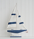 Tall decorative white and navy blue boat