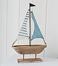 Decorative wooden boat in pale colours
