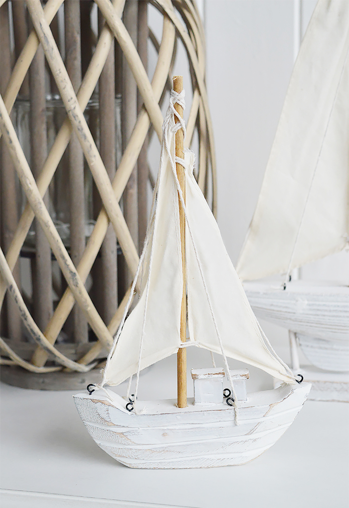 Nautical New England Coastal  Furniture and accessories for the home. A decorative white yacht from the White Lighthouse Furniture and Home interiors