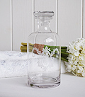 Decorative glass bottle for bedroom as a dressing table accessoryor bathroom
