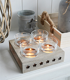 Nantucket candle holder with stars from The White Lighthouse. New England , coastal, country and white furniture and home interiors for the hallway, living room, bedroom and bathroom