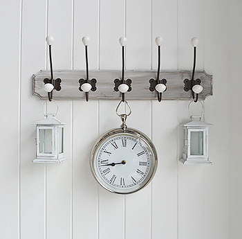 Wooden hooks with clock for wall feature.