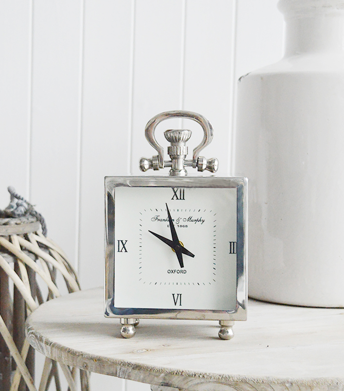The White Lighthouse. White Furniture and accessories for the home. A polished silver mantel clock in style of carriage clock to add a touch of luxury to your room. New England, coastal, country and city home interiors and furniture