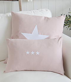 The New Hamptons pink and white cushions. Available with a larger single white star or three smaller stars from The White Lighthouse New England, country, coastal and white furniture for the hall, living room, bedroom and bathroom - triple
