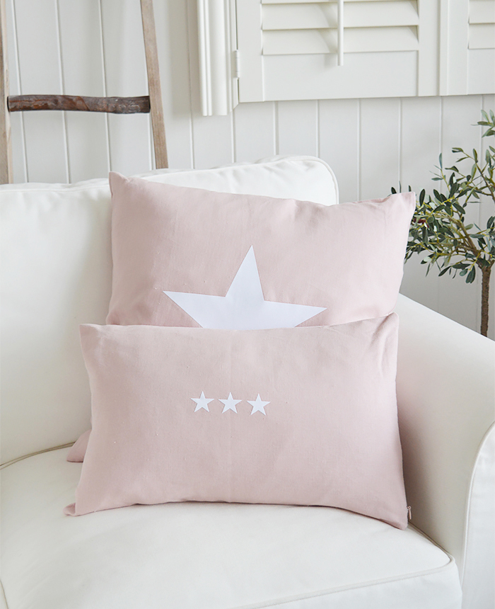 The New Hamptons pink and white cushions. Available with a larger single white star or three smaller stars from The White Lighthouse New England, country, coastal and white furniture for the hall, living room, bedroom and bathroom