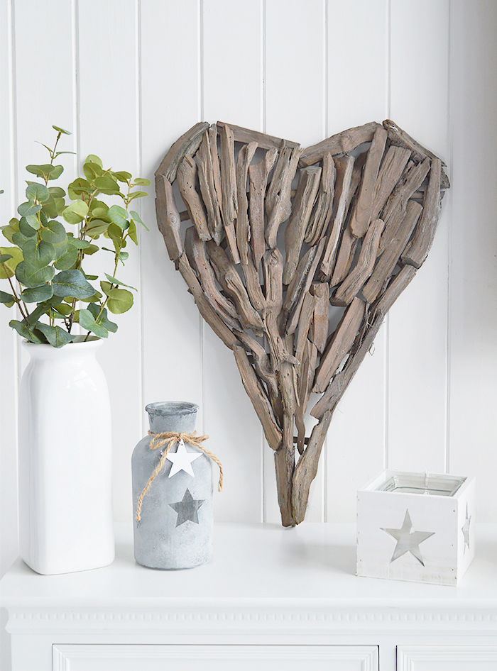 A decorative heart made from pieces of driftwood that can be wall hung or set on a shelf or table top.  In a rustic styled finish, the heart can be incorporated into a country, cottage or coastal interior design.