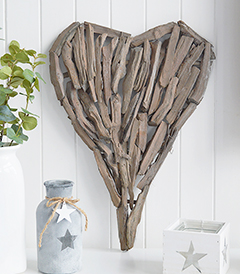 A decorative heart made from pieces of driftwood that can be wall hung or set on a shelf or table top.  In a rustic styled finish, the heart can be incorporated into a country, cottage or coastal interior design from The White Lighthouse, Hallway, Bedroom and Living Room furniture and interiors