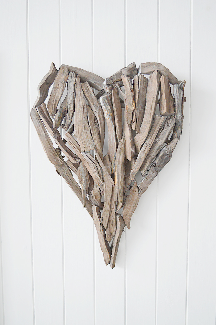 A decorative heart made from pieces of driftwood that can be wall hung or set on a shelf or table top.  In a rustic styled finish, the heart can be incorporated into a country, cottage or coastal interior design. from The White Lighthouse