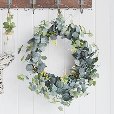 A very realistic, natural and beautiful looking Eucalyptus wreath with twigs for adding greenery to your home. 							  Ideal as a centre piece on a table or can be hung from a wall.