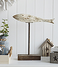 Sitting on top of a weathered stand, the large distressed wooden fish in whites, blues and greys will definitely make a statement in a coastal styled home. The White Lighthouse Furniture