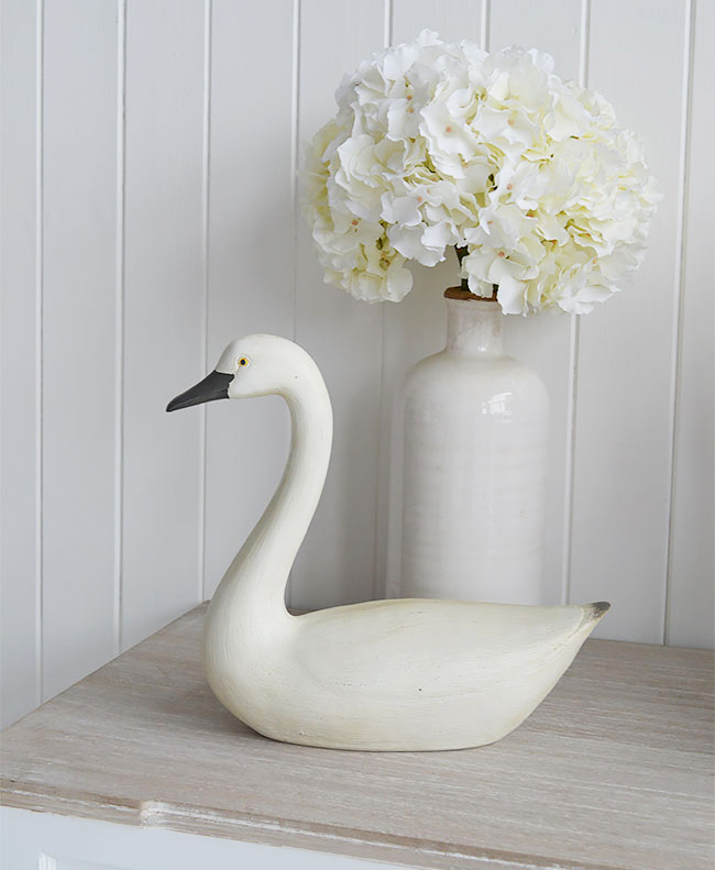Decorative swan or goose on table for living room interiors.
