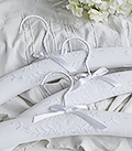 White embroidered hangers
