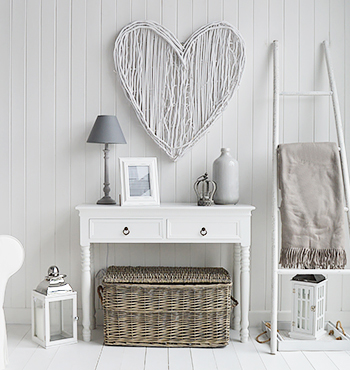 white living room with grey baskets under console table for extra storage furniture