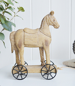 A carved wooden effect decorative horse on wheels from The White Lighthouse Coastal furniture