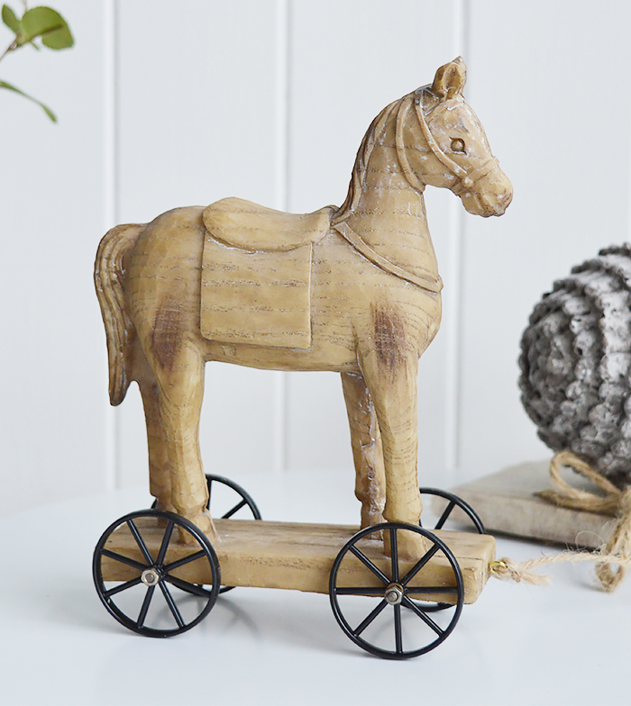 A carved wooden effect decorative horse on wheels from the White Lighhtouse New England style furniture and home interiors