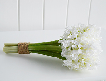 Real looking white bunch of artificial white Hyacinths