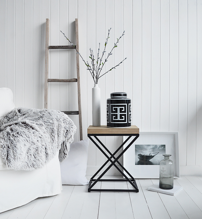 New England living room. A black and white palette is timeless. Mixed with natural materials, cushions and throws with plently of texture and interest gives a classic New England look to your interior.
