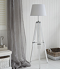 White tripode wooden floor lamp with chrome
