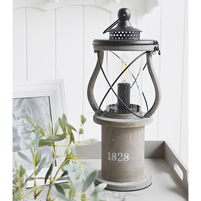 The Lewiston is a charming Victorian grey wooden lantern table lamp.