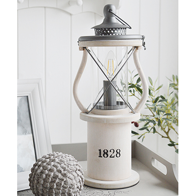 The Lewiston is a charming Victorian white wooden lantern table lamp.