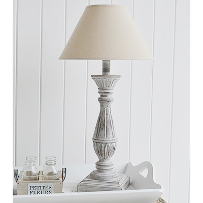 The Lyon grey distressed wooden table lamp in a rustic finish with a slight hint of pink and line cream lampshade.