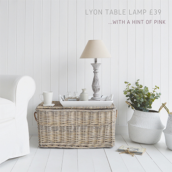 One of the baskets from the of grey lidded set £76 used as a lamp table with our Lyon lamp £39 in hints of pink and grey alongside the Kingston baskets £27