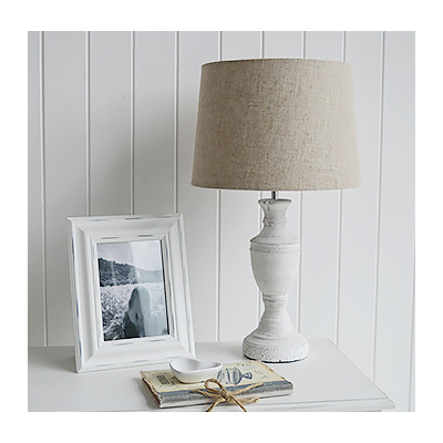 The Rockport table lamp with an urn shaped base and natural linen style lamp shade.