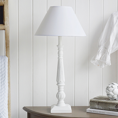 A wooden white table lamp with white shade