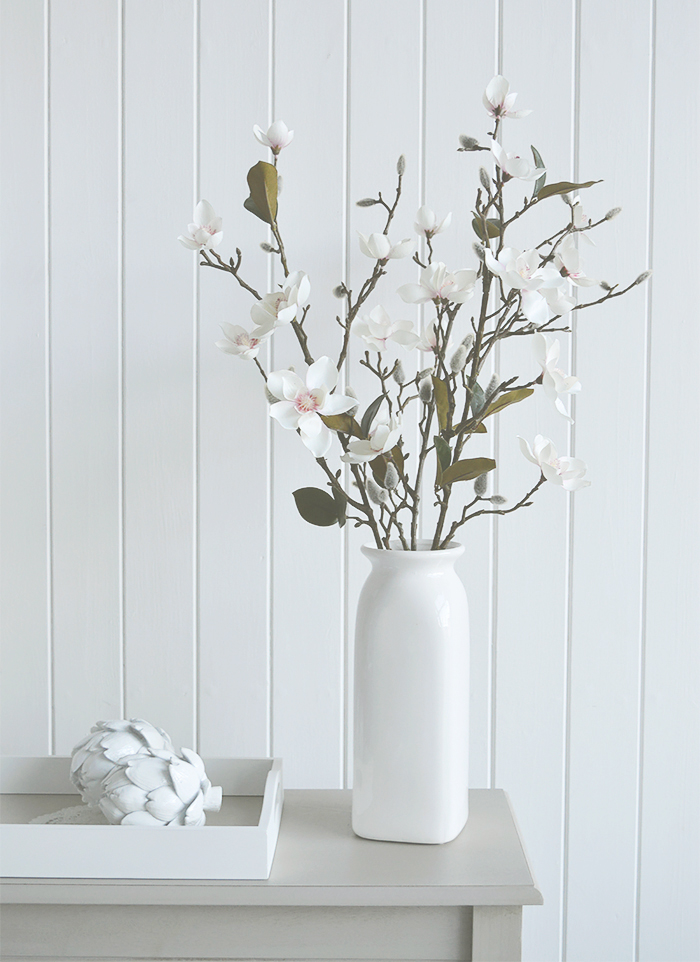 Realistic artificial Magnolia branch with flowers, leaves and buds