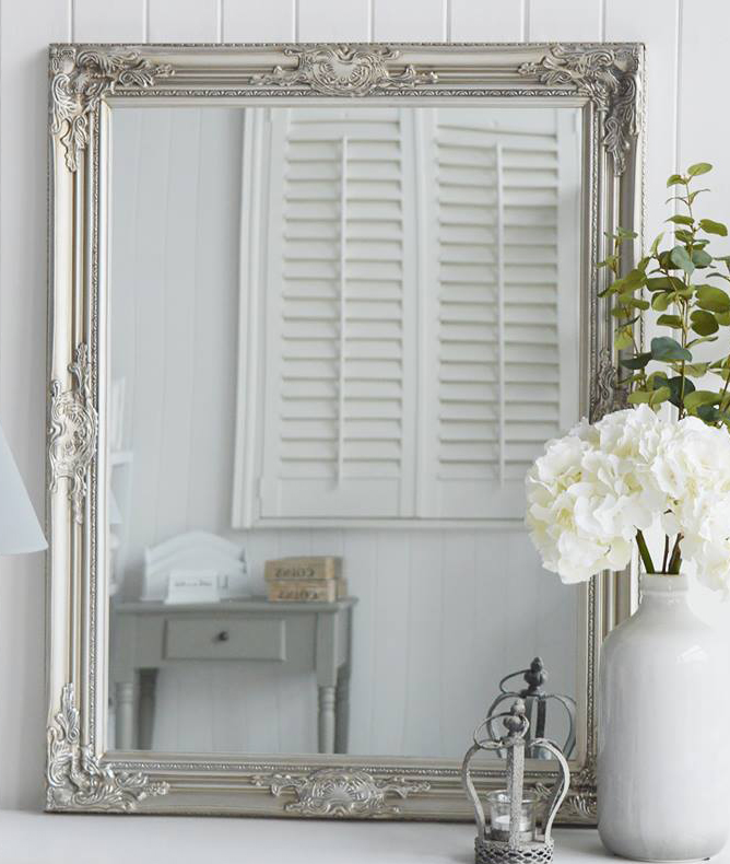 Large silver wall mirror with ornate chunky frame. Can be hung landscape or portrait