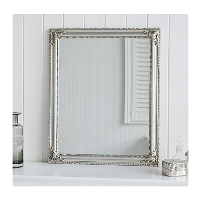 A silver ornate mirror, can be wall hung either landscape or portrait.
