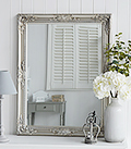 Large silver ornate wall mirror