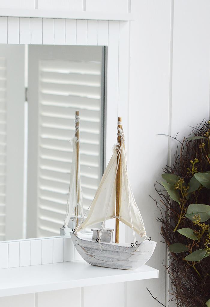 White bathroom mirror with a shelf for coastal bathroom decor