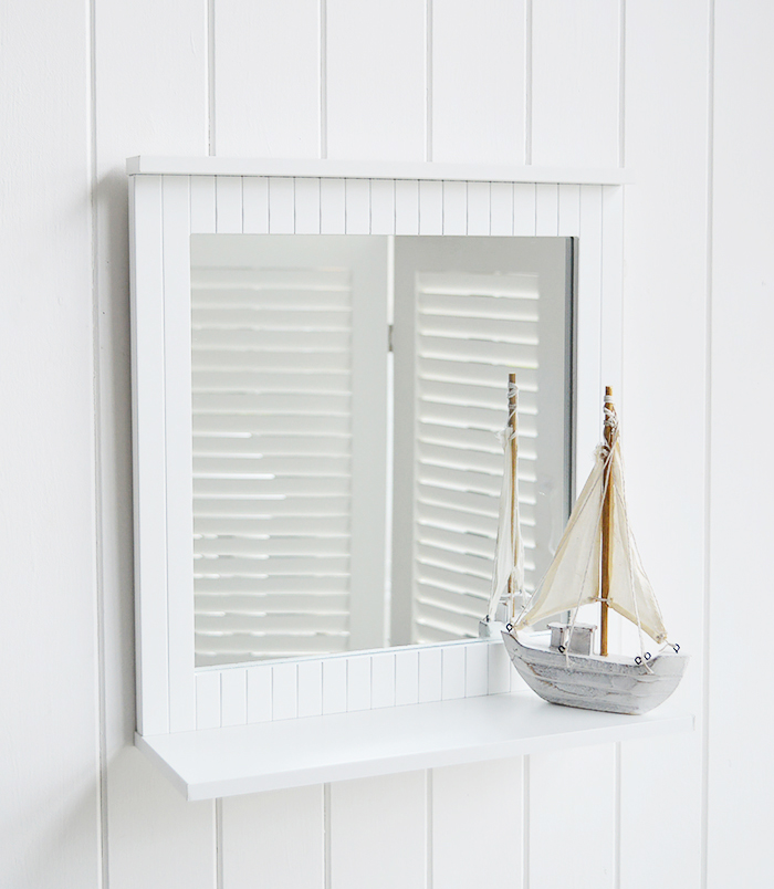 White Bathroom with a shelf for decorating a bathroom in typical New England style decor