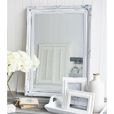 The Versailles large white wall mirror with bevelled glass and a white distressed ornate frame reminiscent of a french chateau. The mirror can be wall hung or simply rest on a table top for dressing or console table.