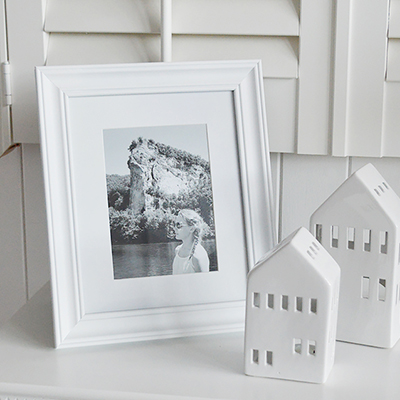 A simple white wood photo frame with a mount.