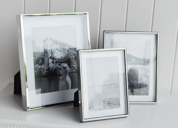 Silver photo frames with white mount