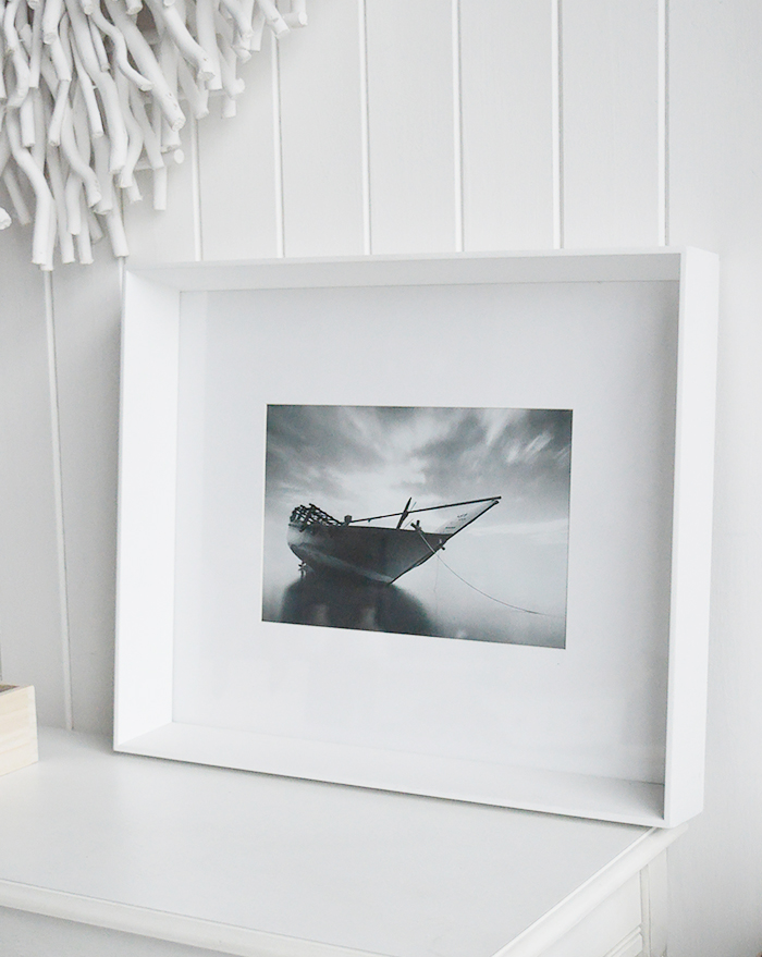 A white large box wooden photo frame for 12 x 8 photographs - wall hung or standing. White Furniture and accessories for the home. New England Coastal and Country for the hallway, living room, bedroom and bathroom from The White Lighthouse Furniture to sit on a shelf or table top