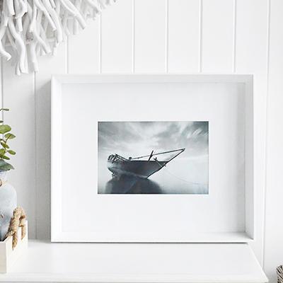 A large white box frame with wide white mount for a 12 x 8 photo or picture.