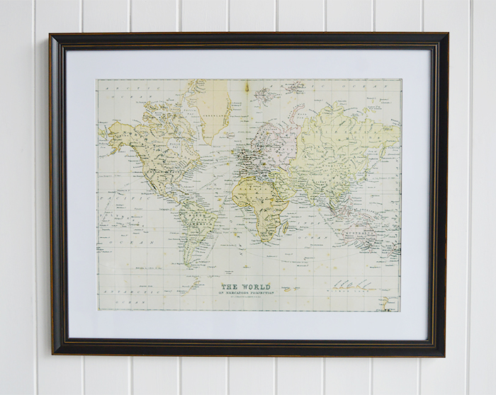 framed print of The World on Mercators Projection by J. Barthholomew P.R.G.S in a vintaged black frame with a thick white mount.