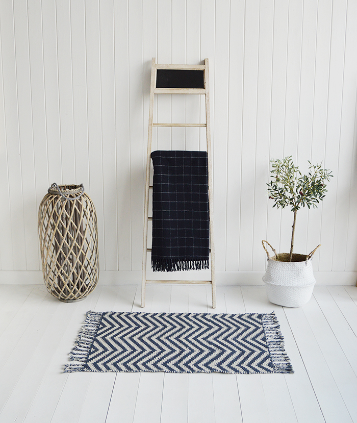 Dorchester blanket ladder with the New Hampshire navy check throw
